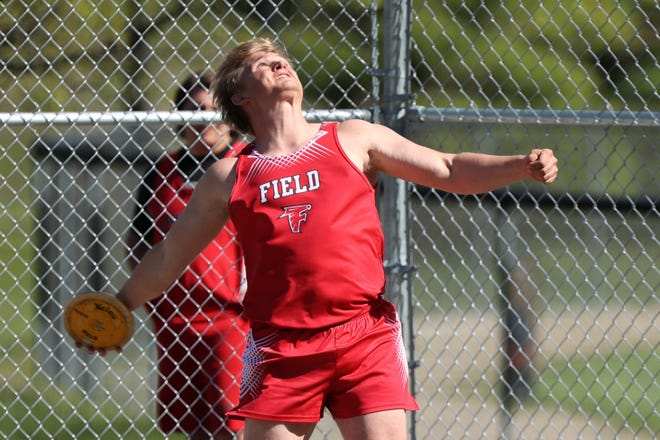 Field's Grant Weise on his final throw for a first-place finish at the Metro Athletic Conference Championships at Ravenna High School.