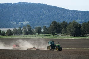 A tractor works a parcel of farm land in the Klamath Basin near Klamath Falls in 2015. Lane County commissioners will then discuss and take action on a possible declaration of local emergency related to current and projected extreme drought weather this week.