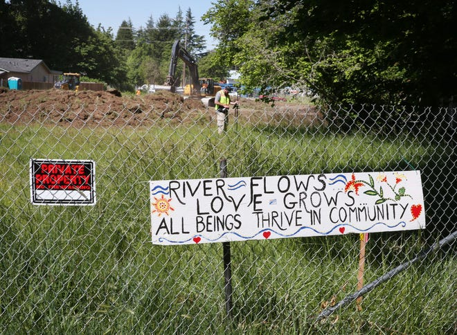 Construction crews working for Evergreen Housing Development Group clear a 3.5-acre site near Maurie Jacobs Park in preparation for the construction of theLombard Apartments project on Friday, May 14, 2021.