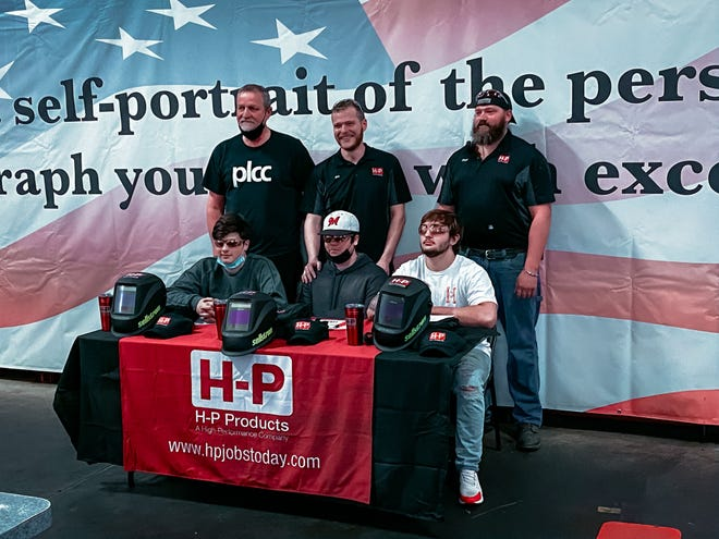 H-P products signed three welding apprentices to to jobs at the company. The new employees are (seated) Colin Ambriola, Brendan Longwell and Jordan Smetts. Joining them are (standing) Mike Kapas, welding instructor at Portage Lakes Career Center, and and H-P welding managers Jon Jones and Zach Wincek.
