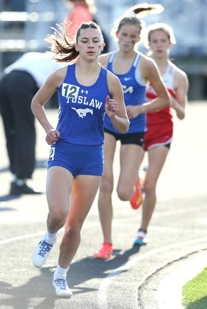 Tuslaw's Malena Cybak places first in the 1,600-meter run at last week's PAC 7 track and field meet.