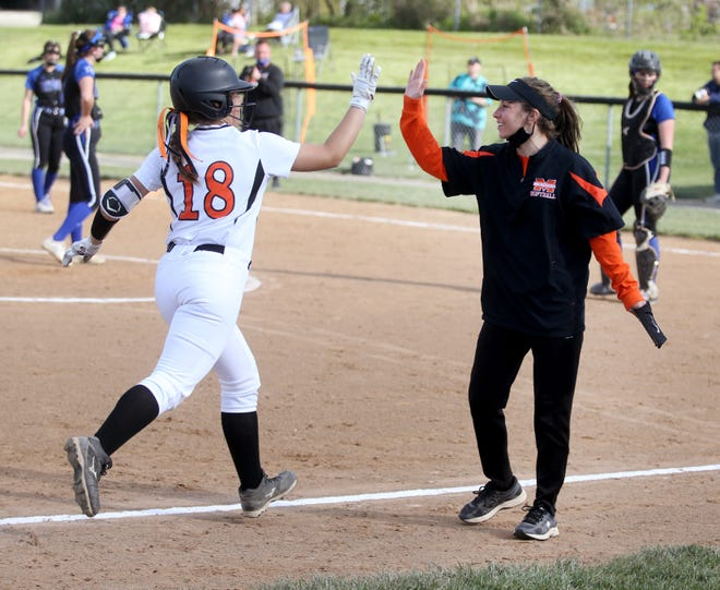Laura Kohmann gets a high five from her coach Jessica Moracz as she heads home after a lone home run in the third inning against Lakeview High School.