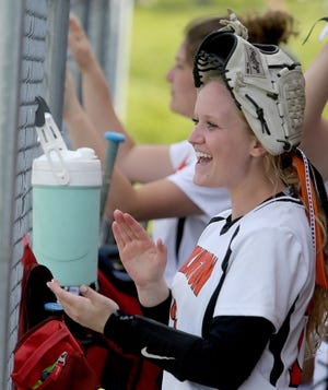 Morgan Davis cheers on her teammates from the dugout in a recent game against Lakeview.