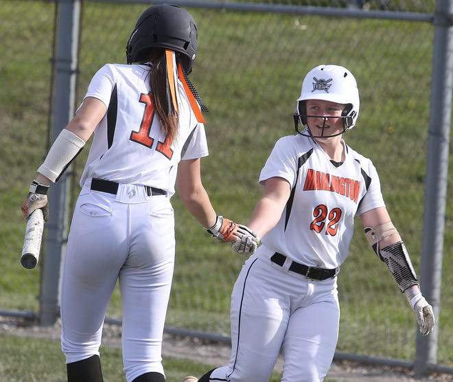 Marlington's Audrey Miller (22) gets five from teammate Chelsea Evanich after scoring in the third inning against Lakeview at Marlington.