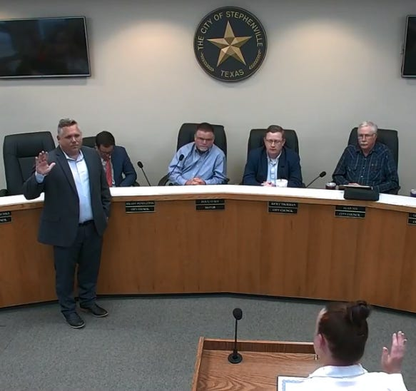 New Place 3 Stephenville City Councilman Daron Trussell is sworn in by City Secretary Staci King during Tuesday's meeting.