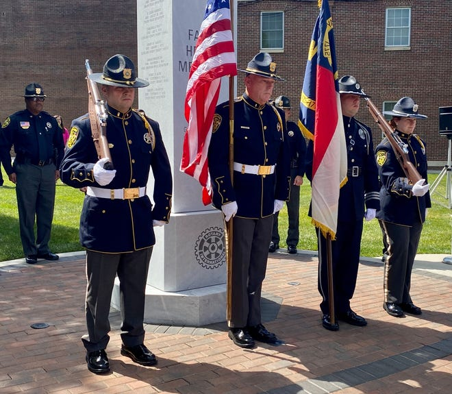 A color guard present flags at the Peace Officers Memorial ceremony on Friday.