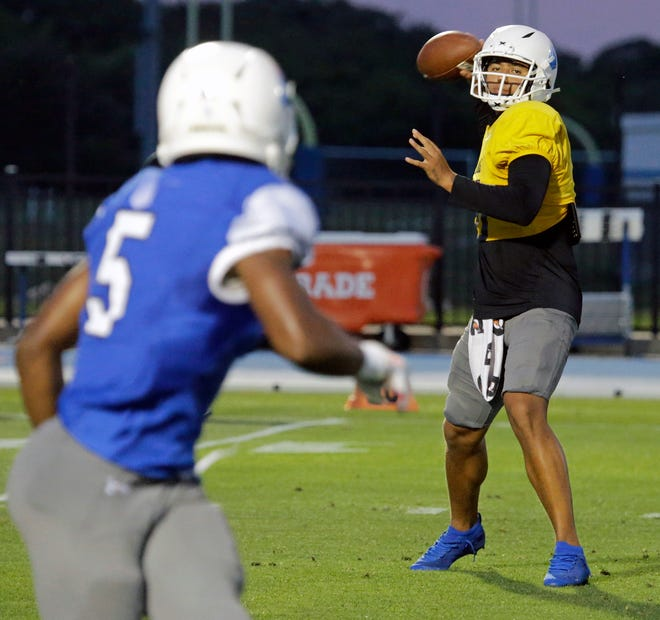 IMG Academy quarterback AJ Duffy throws a pass during Thursday's intersquad scrimmage at IMG Academy in Bradenton.