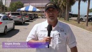 A still shot of Sarasota Mayor Hagen Brody in a video recapping a vaccination effort at the Van Wezel Performing Arts Hall.