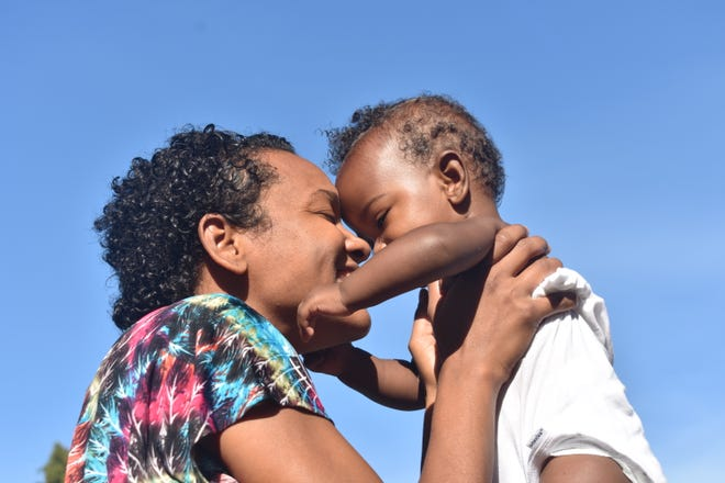 Singer and actress Syesha Mercado with her infant son Amen'Ra, who was placed in foster care after she and her partner, Tyron Deener brought him to All Children's Hospital for care.