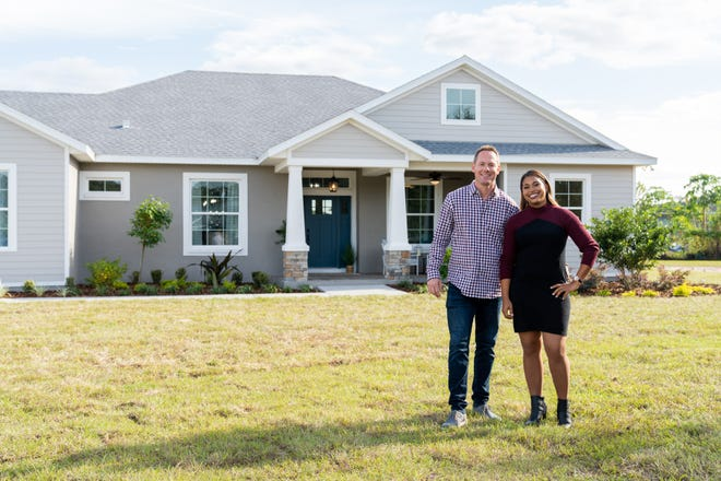 """Brian and Mika Kleinschmidt outside one of the houses they design and build on their HGTV series """"100 Day Dream Home."""""""