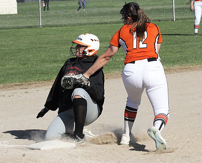 Marcellus third baseman Erin Morgan tags out a Bloomingdale runner at third base in prep softball action on Thursday.