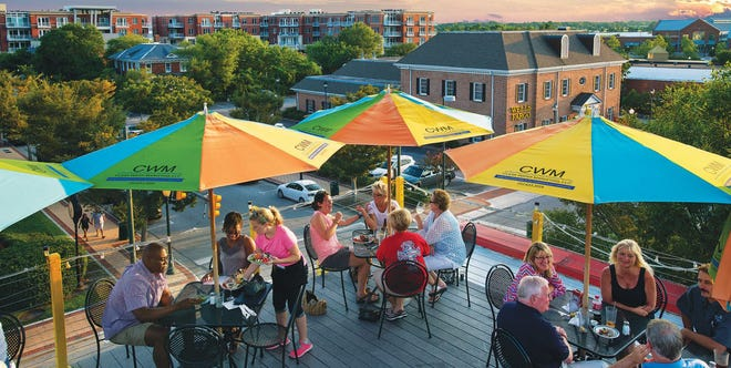 Tourists enjoy downtown New Bern restaurants and sites.