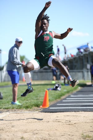 Highland Park's Tre Richardson soars to a jump of 22 feet, 2.5 inches in the long jump at Thursday's Centennial League meet at Washburn Rural. Despite limited practice in track this spring while dual-sporting with baseball, Richardson has made a mark, winning the 200 at both City and league and taking second in both the long and triple jumps at league.