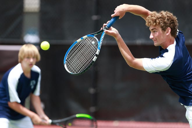 Hayden's Michael Sandstrom returns a volley while teammate Gus Glotzbach backs him up during their doubles match at Friday's state qualifer at Kossover Tennis Complex.