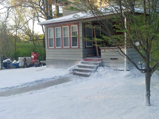 """Faux snow covers a property on Colby Avenue in Worcester, where film crews from """"Dexter"""" were shooting a winter scene early Friday."""
