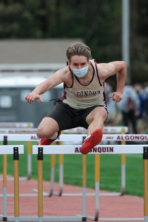 Alqonquin's Ben Westphal clears a hurdle during a recent 110-meter event against Shrewsbury.