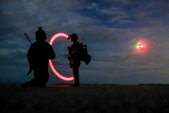 Special Forces Soldiers assigned to 3rd Special Group signal a UH-60 Black Hawk Helicopter for exfiltration during a training rotation on Aug. 15, 2019, near Hurlburt Field, Florida.