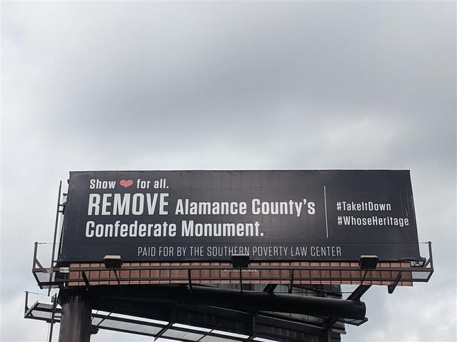 A billboard, paid for by the Southern Poverty Law Center, urges Alamance County to remove its Confederate monument.