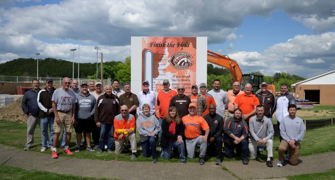 """Twenty eight former and current Claymont coaches gathered Wednesdayto support the """"Finish the Field"""" project at Claymont Stadium."""