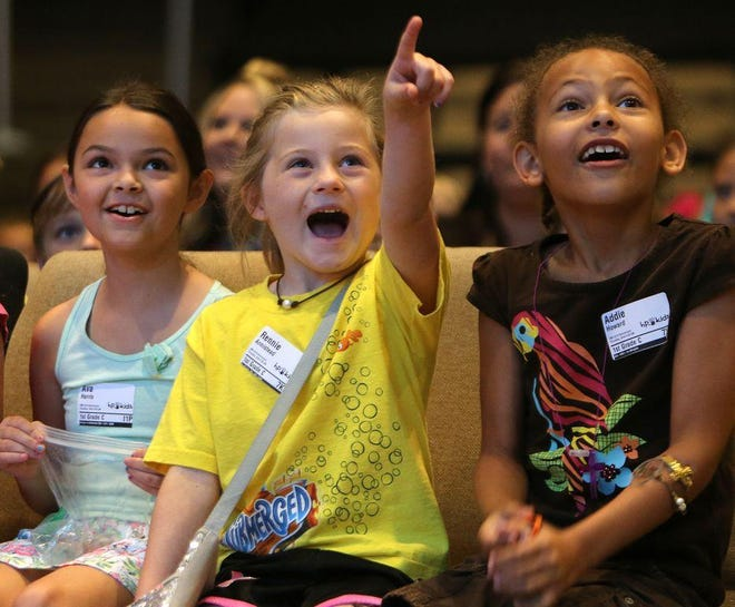Children react to a video during Vacation Bible School at Hiland Park Baptist Church in 2016.