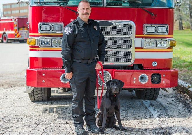 San Bernardino County Fire Investigator Shawn Reiss and arson dog Dinty.