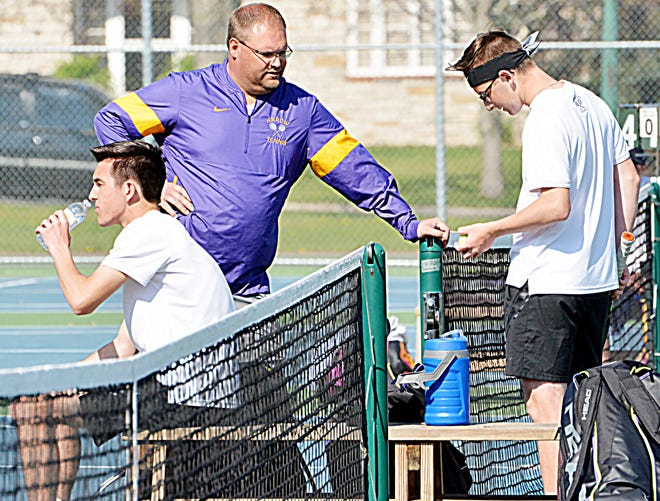 Watertown High School's boys tennis coach visits with brothers Sam (left) and Mark Mahowald (right) during a break in one of their first flight doubles matches Thursday in a triangular at the Highland Park Courts. The Arrows closed out their regular season by splitting duals against Aberdeen Central and Madison.
