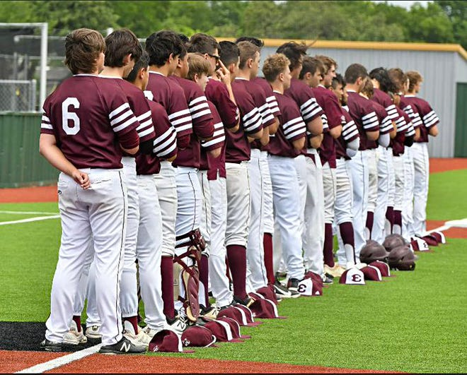 Ennis baseball players line up for the national anthem during a recent game.