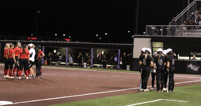 Anson coach Kym Chapa meets with her pitcher and team on the field while Hawley coach Maci Clayton does the same with her batter and players who loaded the bases in the top of the seventh inning of Thursday Region I quarterfinal at Abilene Christian University's Wells Field. Hawley scored six times in the inning to rally to an 11-8 Game 1 win.