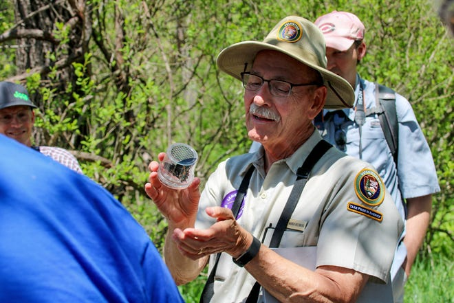 Science at Sugarlands presenter Warren Bielenberg holds a butterfly collected in Great Smoky Mountains National Park. The park is home to nearly 2,000 different species of moths and butterflies.