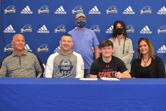 Joined by family and coaches, Harper Creek's Brycen Jones commits to play football at Olivet College at a signing ceremony at Harper Creek  High School on Thursday.