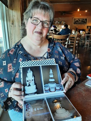 Alena Fox displays photos of a few of her creations from her cake decorating days. Currently employed at the Mt. Vernon Developmental Center, she thinks voiceover work could be in her future.