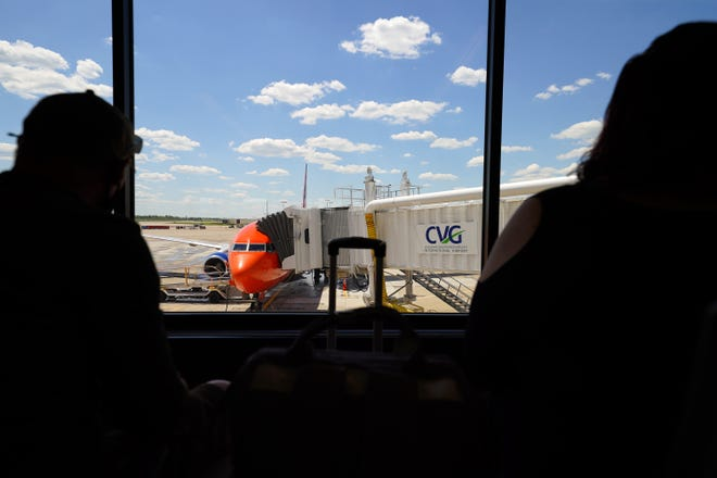 Passengers wait to board the first Sun Country Airlines flight to Minneanpolis, Friday, May 14, 2021, at the Cincinnati/Northern Kentucky International Airport in Hebron, Ky.