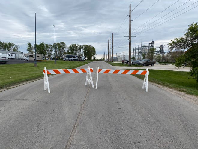 The road leading to the Landus Cooperative grain elevator was closed the morning of Friday, May 14, 2021, after an explosion at the elevator in Jefferson, Iowa.