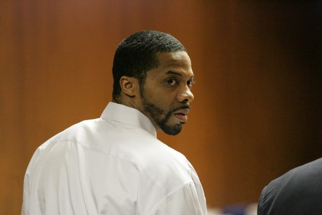 Defendant Juwan Deering glances back after being found guilty of five counts of first-degree murder and one count of arson before Judge Wendy Potts in Oakland County Circuit Court in Pontiac on Aug. 1, 2006.