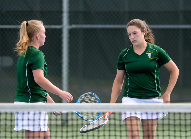CMR doubles teammates Becca Sherman, left, and Madison George touch racquets in between points during their doubles match against Great Falls High's Allison Harris and Baylee Furthmyre at the Crosstown tennis dual two weeks ago at the CMR courts.