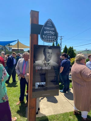 Chester County Mayor Barry Hutcherson speaks with another person while looking at the back side of the sign honoring Eddy Arnold at Sue Shelton White Park in Henderson on Friday, May 14, 2021.