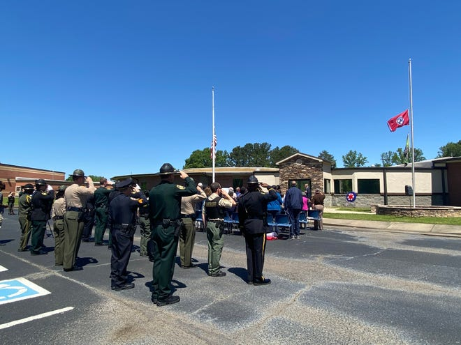 Law enforcement officers salute the flags at the National Law Enforcement Memorial Service Day ceremony at the Madison County Sheriff's Office Friday.