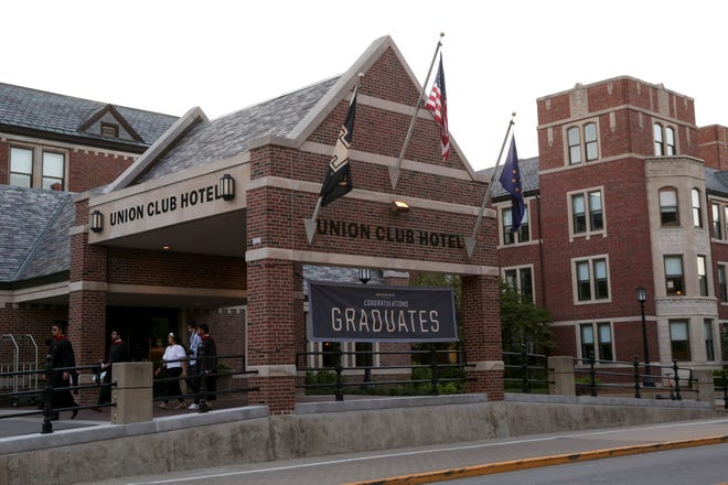 Pedestrians walk past the Purdue Union Club Hotel, Thursday, May 13, 2021 in West Lafayette.