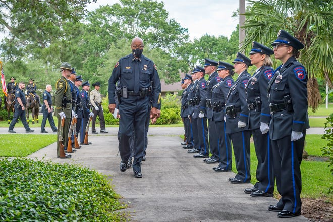 Thomas L. Glover Sr., Chief of Police. leads officers into the church.  The Lafayette Police Department host the annual Police Memorial service at St. Barnabas Church  Thursday, May 13, 2021.