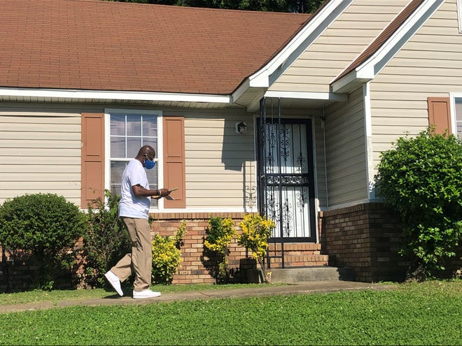 Harold Collins, director of Shelby County's office of reentry, distributes materials about the COVID-19 vaccine to a home in 38106 May 15, 2021.