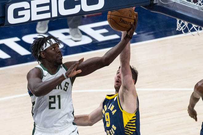 Bucks guard Jrue Holiday has enough space to shoot over Indiana's T.J. McConnell Thursday night.