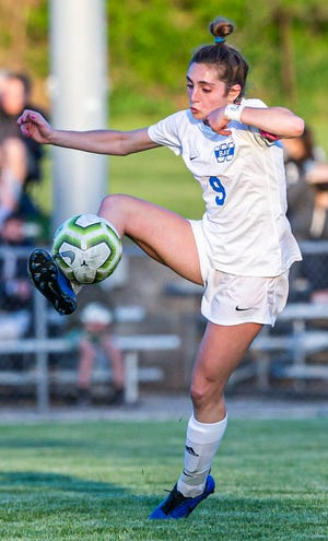 Whitefish Bay's Anna Franceschi (9) traps a pass during the match against DSHA at Quad Park in Milwaukee on Thursday, May 13, 2021.