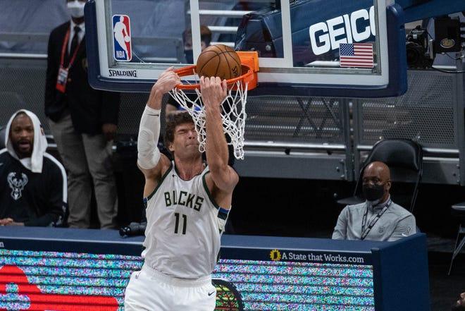 Bucks center Brook Lopez elevates at the rim Thursday night.