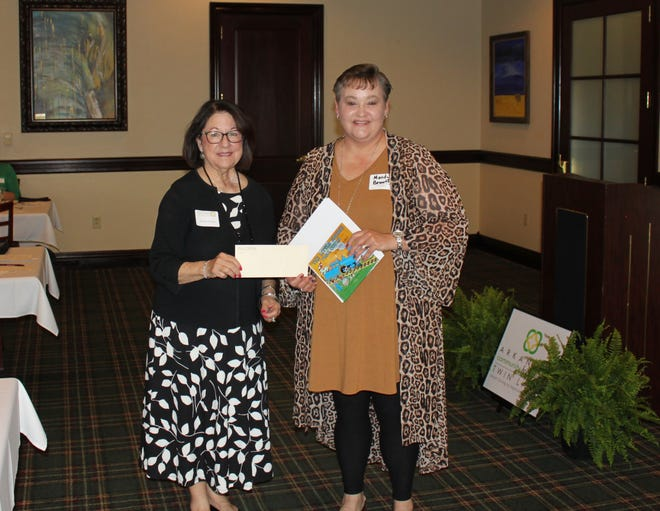 Twin Lakes Community Foundation board member Estella Tullgren presents a $2,000 grant to Mandy Bennett, Baxter County Early Literacy Project representative and Dolly Parton Imagination Library Coordinator for Baxter County.