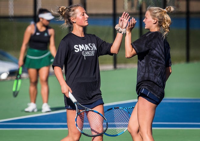 FILE -- Delta's Tynan Dishman and Maggie Manor face off against Yorktown during an event at Delta High School on May 14, 2021.