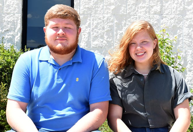 Twins Gabe and MadelineÊFrasure-Lauth didn't spend a ton of time together in classes, but did as part of Watkins Memorial's marching band.