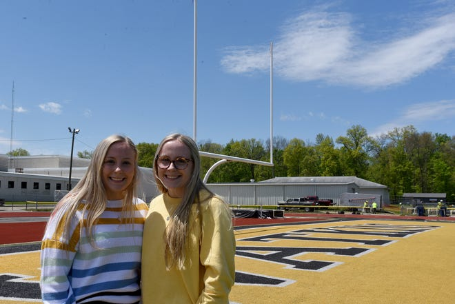 Twins Lindsay and Peyton Fry both cheered together and said they will miss Warriors football Friday nights.Ê