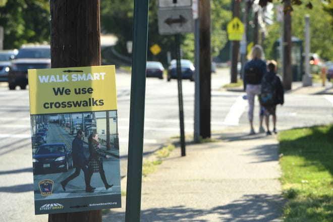 Signs have been posted near the intersections asking pedestrians to use crosswalks in Fair Lawn, N.J. on Friday May 14, 2021.