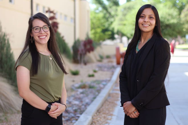 Amber Medina, left, and Anneliese Trujillo pose at New Mexico State University on May, 13, 2021. The two Las Crucens and Mayfield High alumni have both graduated from top universities with their graduate degrees.