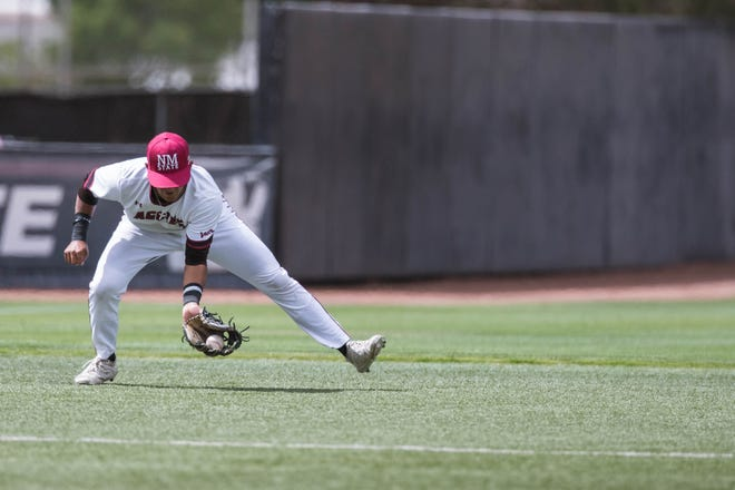 Zerek Saenz (3) fields a ball and throws to first as the New Mexico State Aggies face off against the Cal Baptist Lancers at Presley Askew Field in Las Cruces on Friday, May 14, 2021.